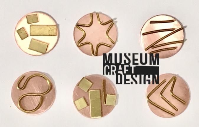 Six metal label pin samples.