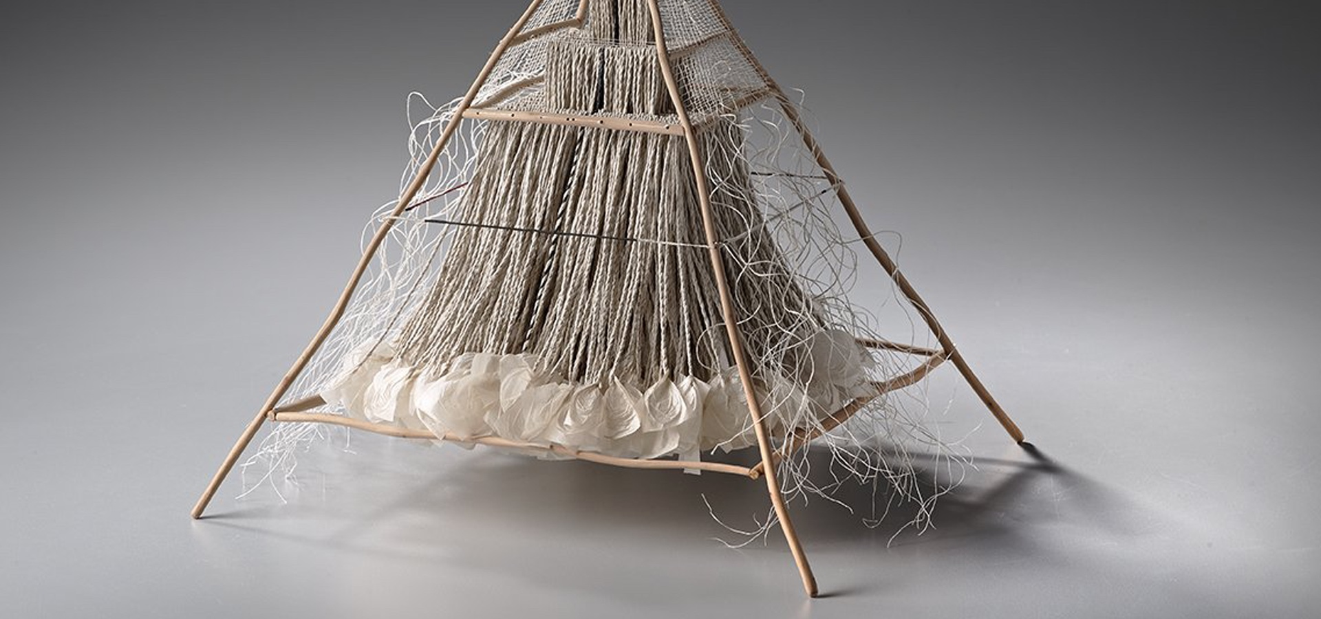 Pyramid sculpture made with wood and twine