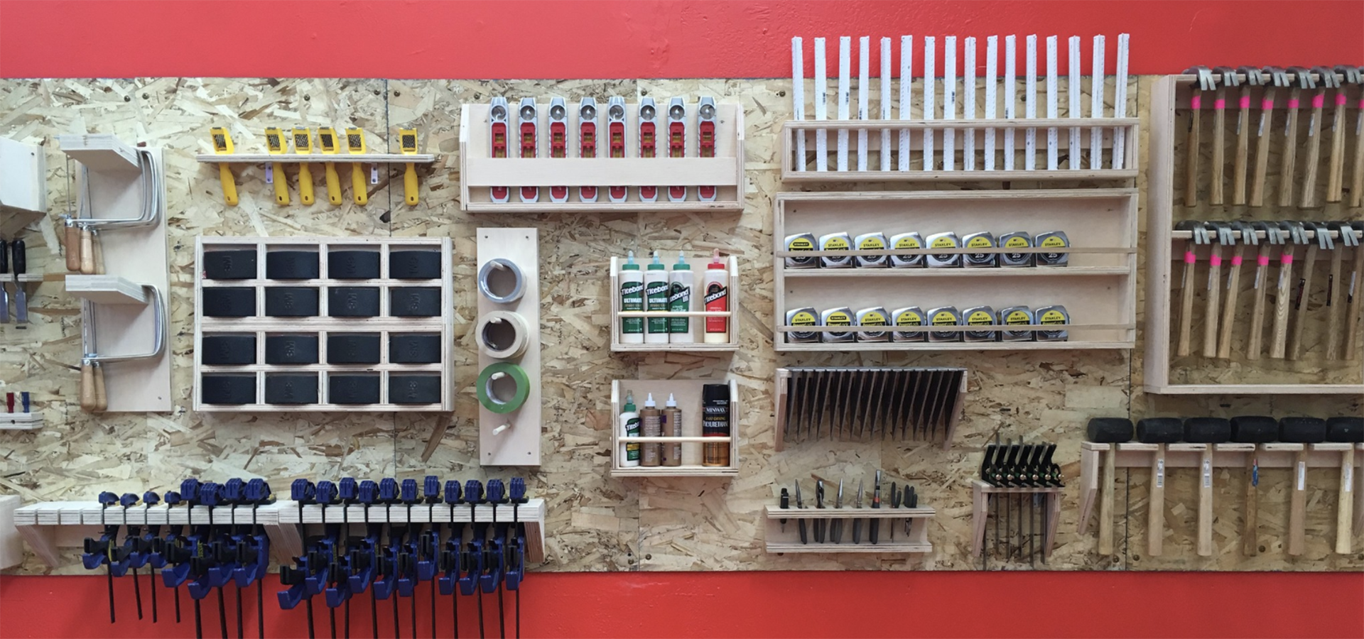 wall of tools organized by size and material