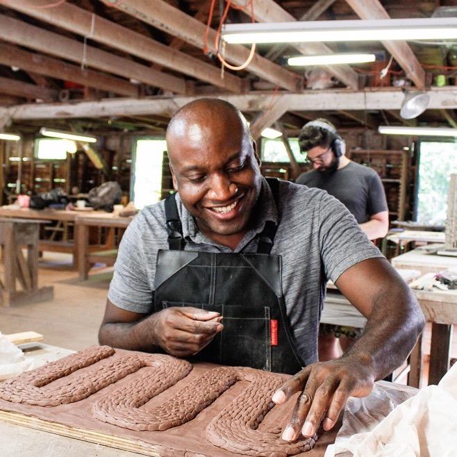 Baralaye working with clay
