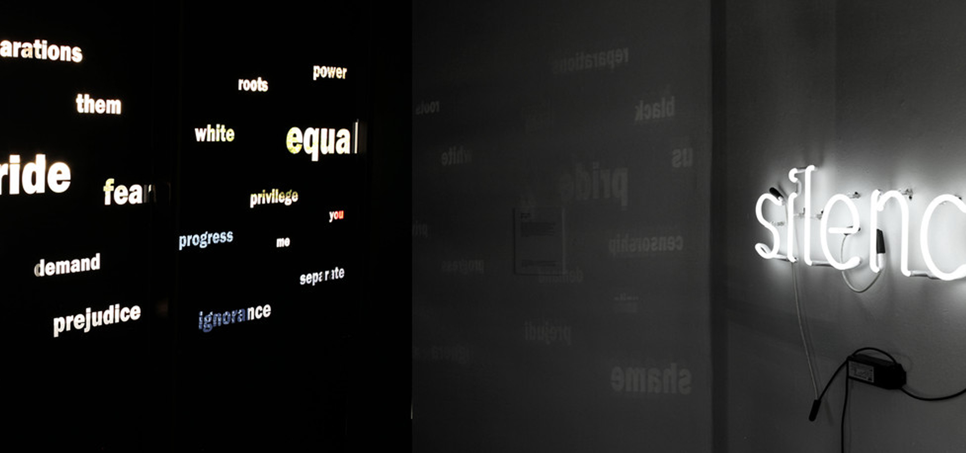 """A neon wall installation with """"silence"""" across from smaller words like """"equal"""" across from it."""