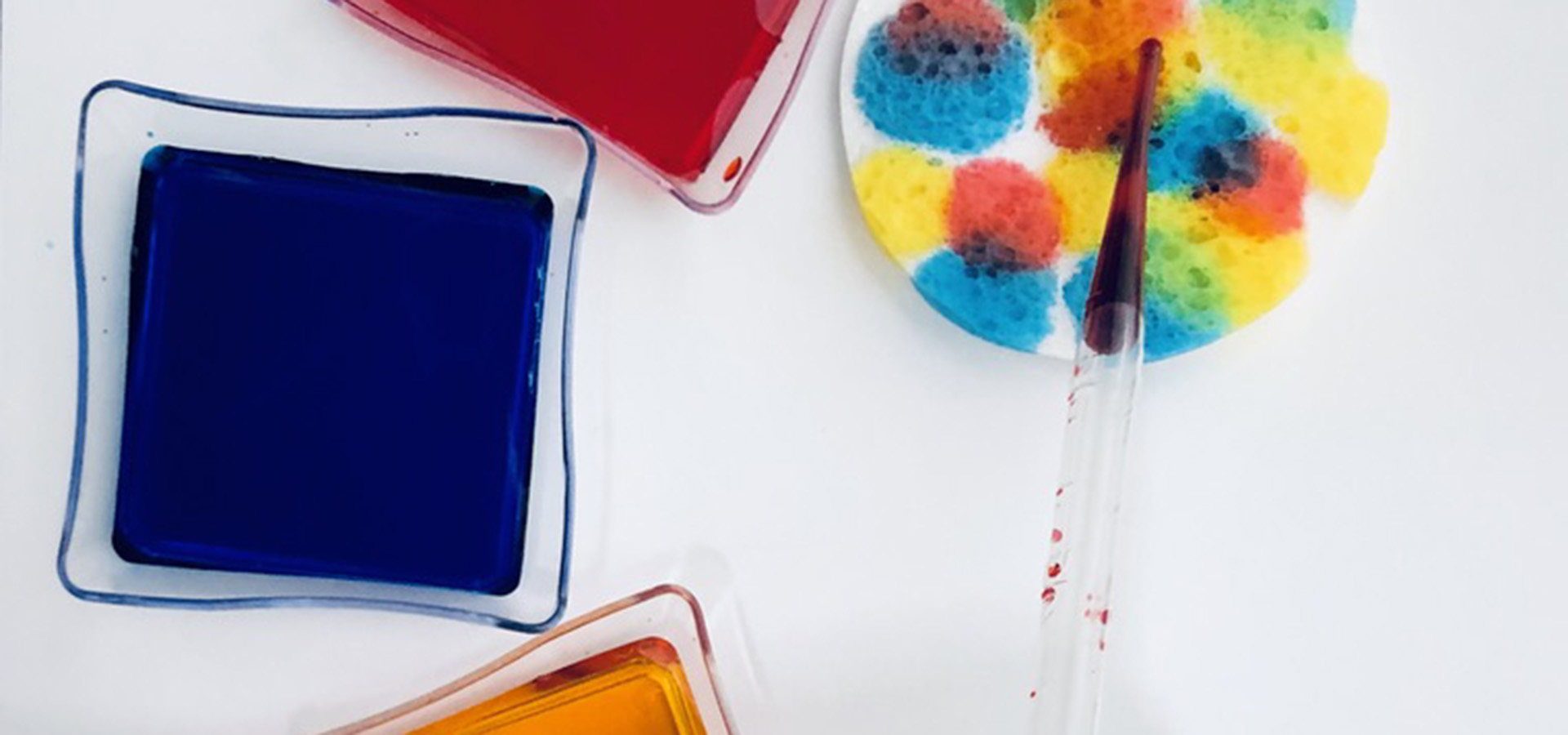 Food coloring and eye dropper and sponge