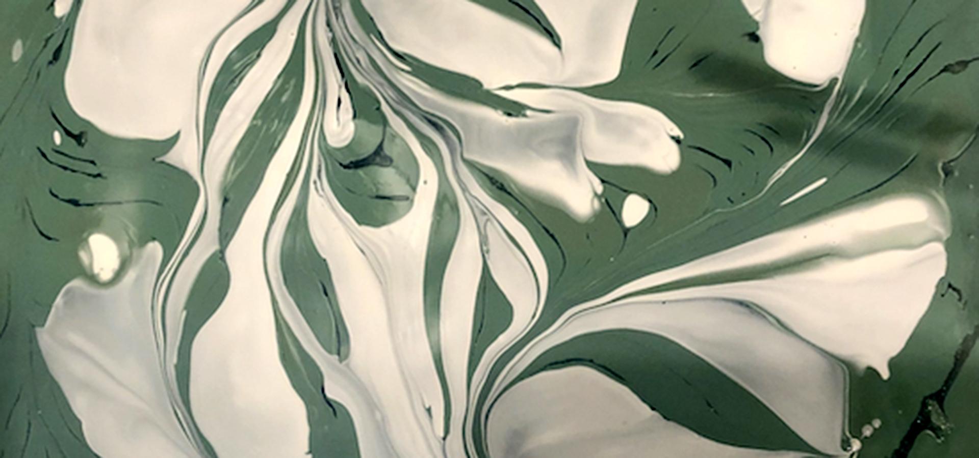 Green and white swirled paint